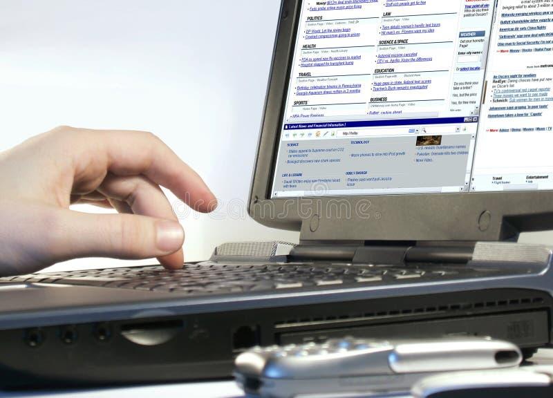 Browsing internet. On a laptop royalty free stock photos