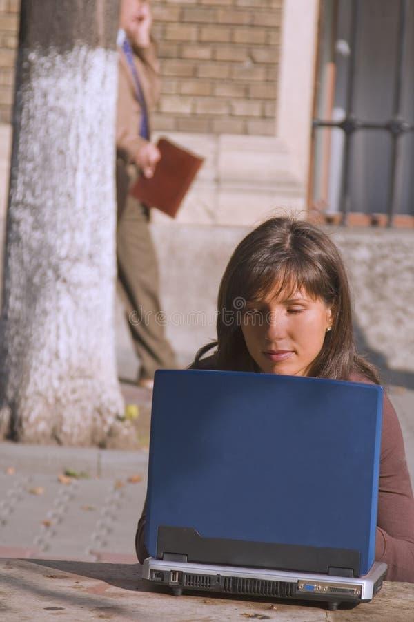 Browsing the internet outdoor stock photos