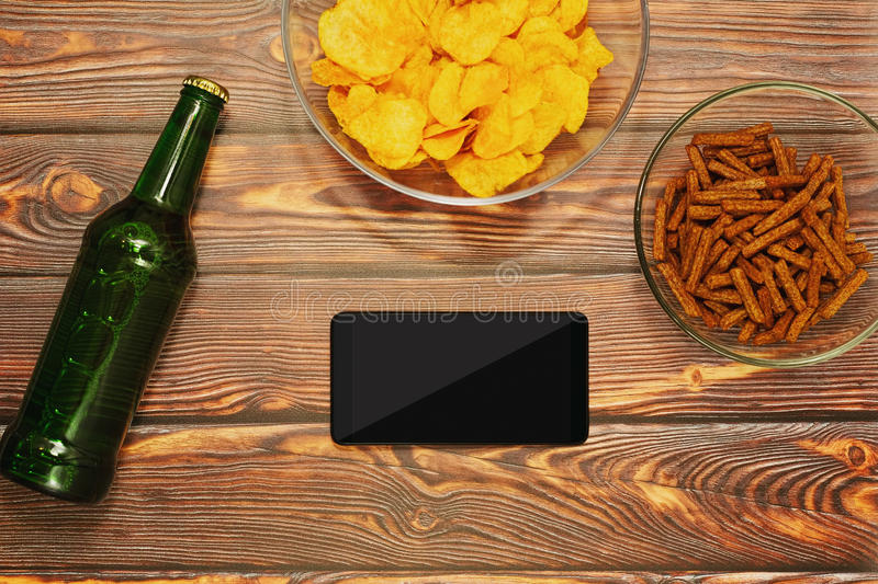 Browsing internet with smartphone in bar concept stock images