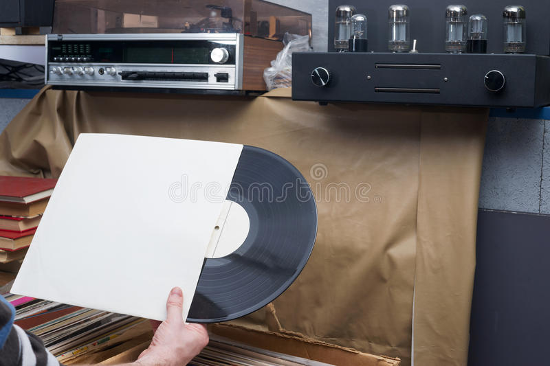 Browsing through vinyl records collection. Music background. Copy space. Retro styled image stock image