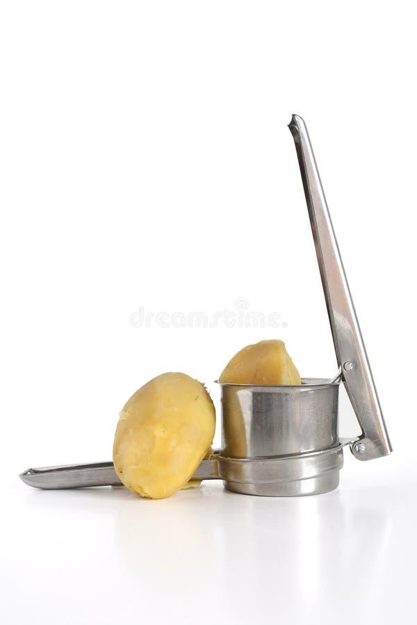 Broyeur de pomme de terre d'isolement image stock