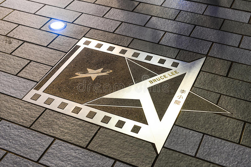 Bruce Lee's hand print at Avenue of Stars in night time. HONG KONG, CHINA - JUN 09, Bruce Lee's hand print at Avenue of Stars in night time, Hong Kong, China stock images