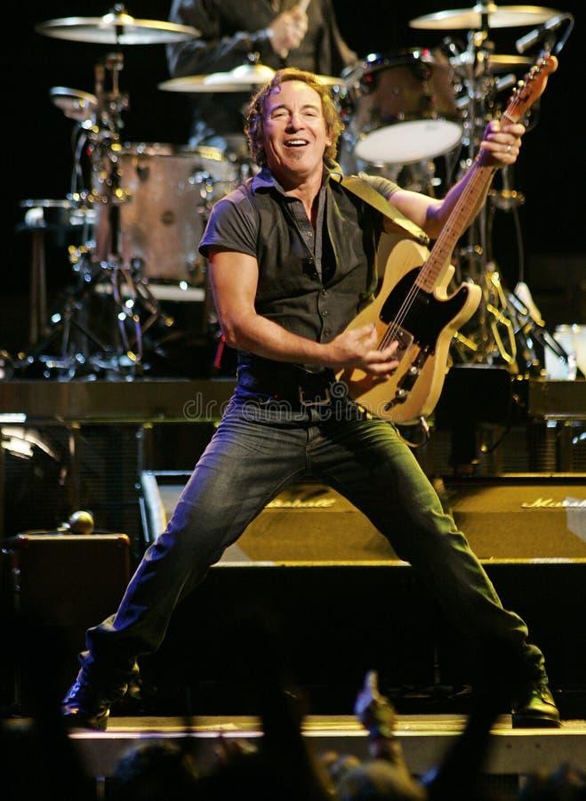 Bruce Springsteen och hans E Street Band utför fotografering för bildbyråer
