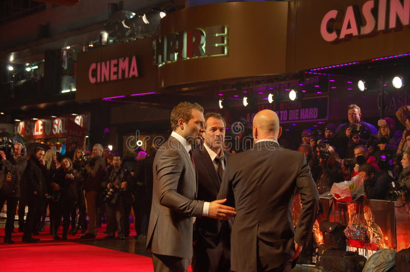 Bruce Willis en Jai Courtney en Sebastian Koch royalty-vrije stock foto's