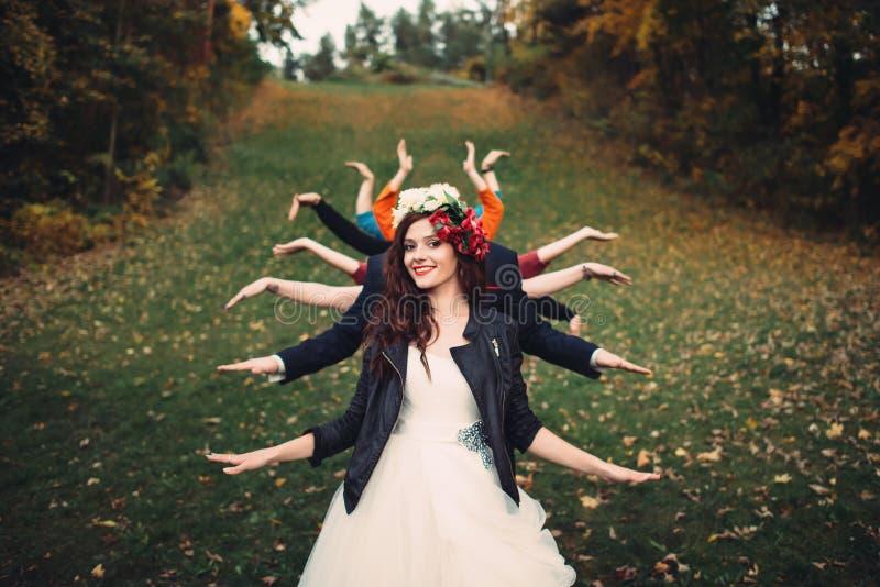 Brud med många händer i en skog royaltyfria foton