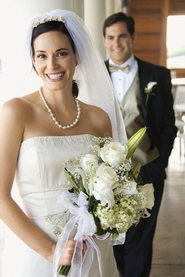 brudbrudgumstående royaltyfri foto