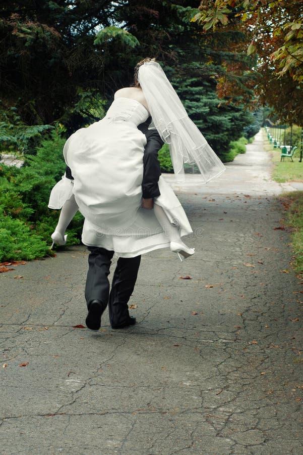 brudgumflykt royaltyfria bilder