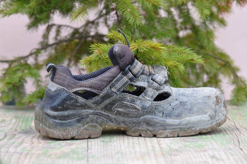 Brudni działanie buty zdjęcia stock