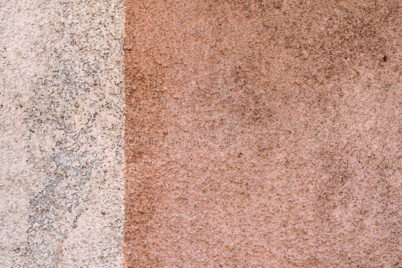 Brudzi dwa barwiącą ścianę, szczegółową zdjęcia stock