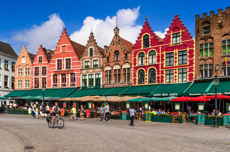 Bruges, Belgium. 7 AUGUST 2014. Tourists on street cafes in Bruges, Markt is meeting place of the Brugelings and tourists in Brugge, Flanders stock photo