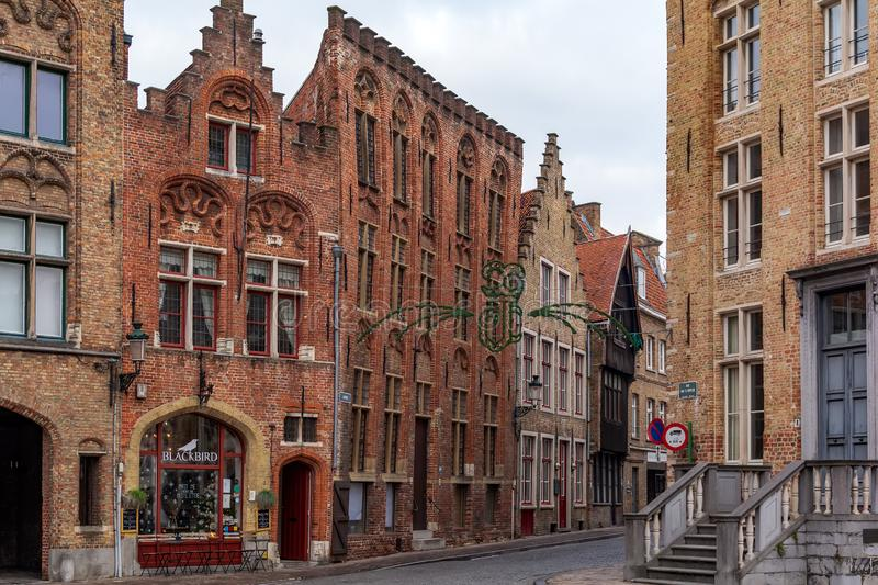 Old street of Bruges with traditional medieval houses of red brick royalty free stock photography