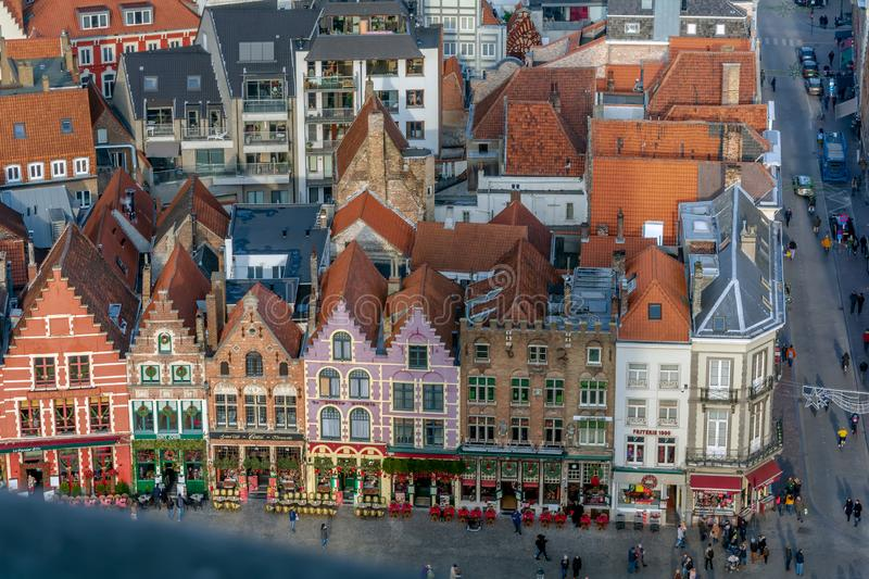 View to Bruges medieval Market Square Markt with colorful decorated guild houses stock photography