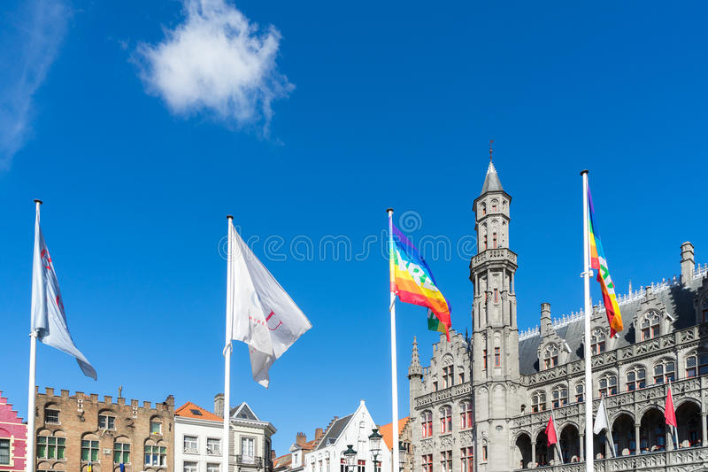 BRUGES, BELGIUM/ EUROPE - SEPTEMBER 25: City Hall in Market Square in Bruges West Flanders Belgium on September. 25, 2015. Unidentified people stock photos