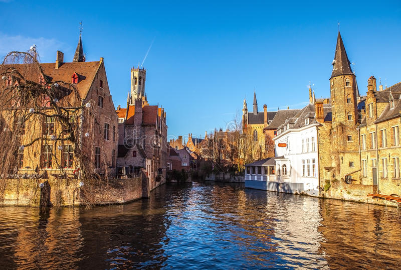 Bruges, Belgium. Image with Rozenhoedkaai in Brugge, Dijver river canal and Belfort (Belfry) tower stock images