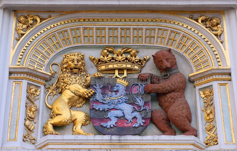 Heraldic lion and bear, town hall Coat of arms , the city arm of Bruges, Belgium, Europe. BRUGES, BELGIUM - May 29 , 2019 : Heraldic lion and bear, town hall stock photography