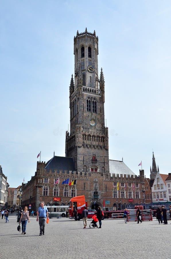 Bruges, Belgium - May 11, 2015: Tourist visit Belfry of Bruges on Grote Markt square. royalty free stock images