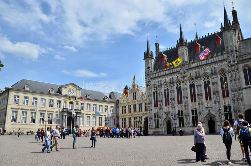 Bruges, Belgium - May 11, 2015: Tourists on Burg square in Bruges, Belgium royalty free stock photo