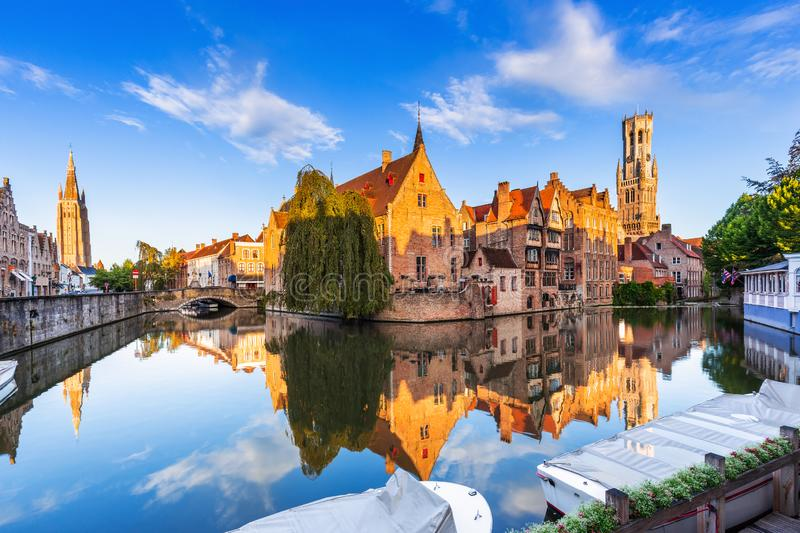 Bruges, Belgium. The Rozenhoedkaai canal in Bruges with the Belfry in the background stock photos