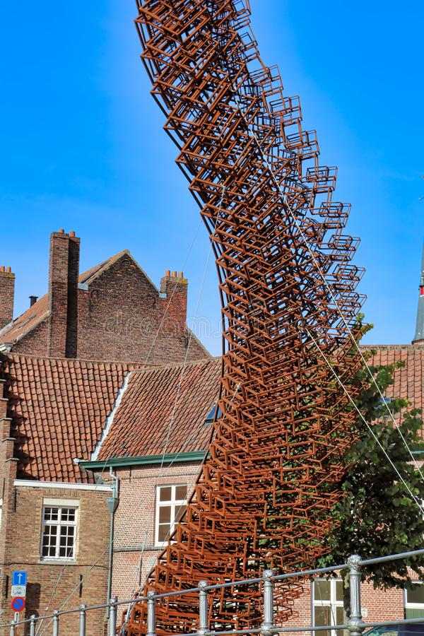 Bruges, Belgium: September 29th 2018; a modern sculpture offers a contrast to the historic buildings of central Bruge stock image