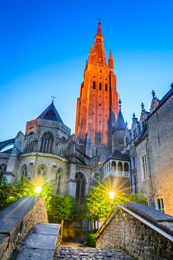 Bruges, Belgium. Twilight image with Church of Our Lady (Vrouwekerk) dating from 13th century, tallest structure in the city and the second tallest brickwork royalty free stock photography