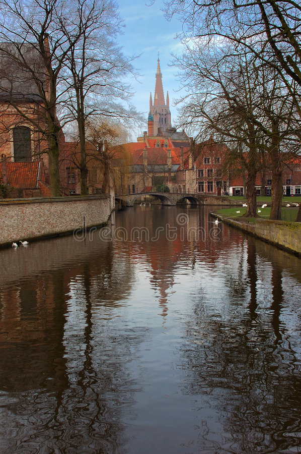 Bruges, brugge. A view of one of the oldest cities in Belgium, Brugge, Bruges, cathedral, church in background. View from the canal stock photography