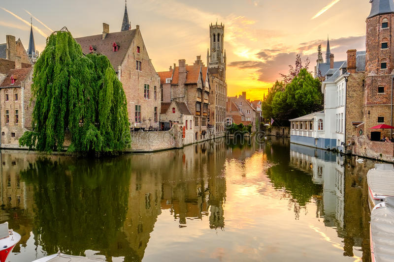 Bruges Brugge cityscape with water canal at sunset stock photo