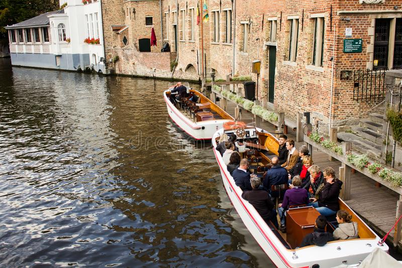 People on a boat in the historic centre of Bruges stock image