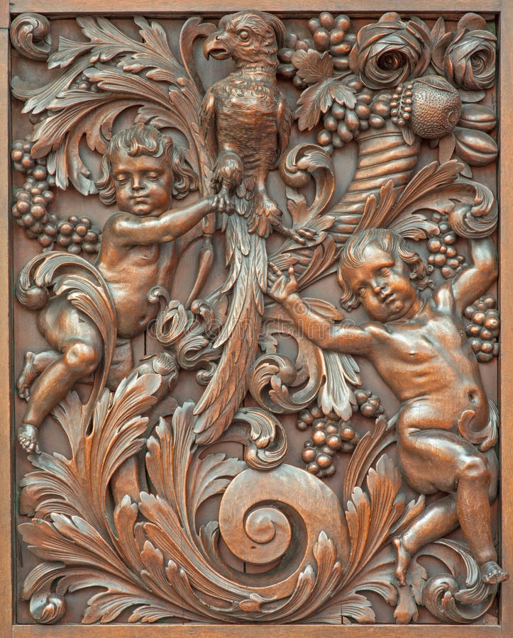 Download Bruges - The Carved Symbolic Relief Of Angels With The Bird In Karmelietenkerk (Carmelites Church) Stock Image - Image: 42842081