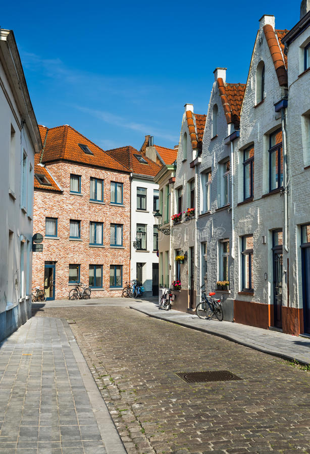 Bruges, Flanders, Belgium. Medieval scenery with paved street and belgium architecture houses in Bruges, landmark of Flanders stock photos