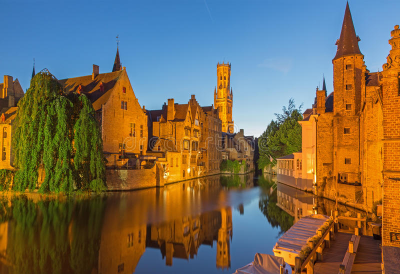 Bruges - View from the Rozenhoedkaai in Brugge with the Perez de Malvenda house and Belfort. Van Brugge in the background in the evening dusk royalty free stock image