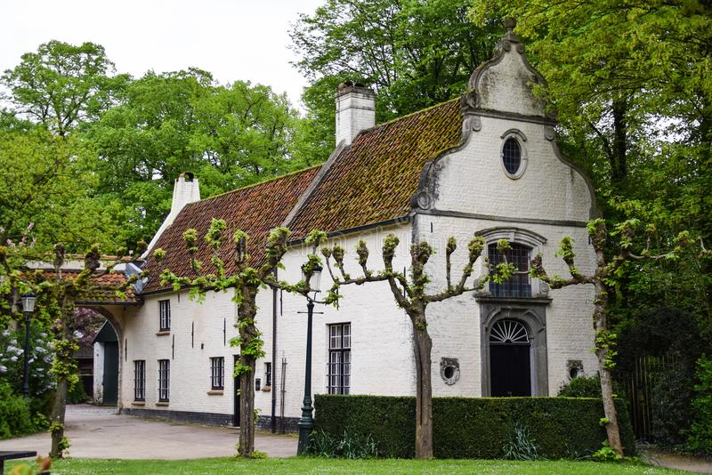 The Bruges White House. A White house surrounded by trimmed trees in Bruges stock photos