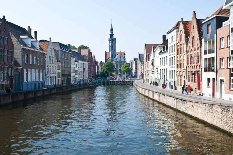 Brugge Belgium. Canal with a church in the background in the historical town of Brugge in Belgium royalty free stock image