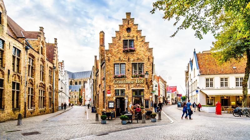 Historic Brick Houses at the corner of Mariastraat and Heilige-Geeststraat in the heart of the medieval city of Bruges, Belgium stock photos