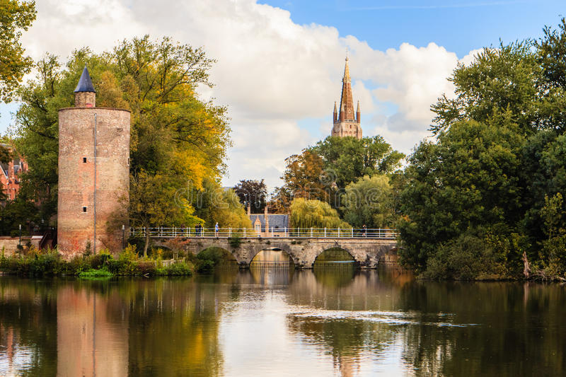 Brugge, Bruges, Belgium. Brugge, Bruges, Flanders, Belgium. A view on the bridge across the Minnewater with left the Poertower (Ammunition Storage Tower) from royalty free stock image