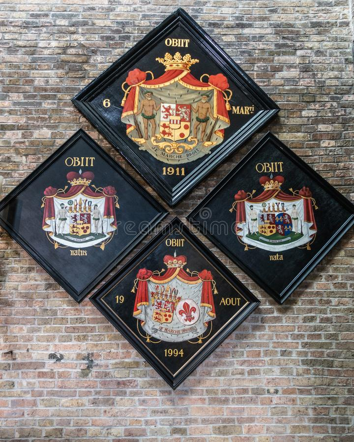 Four family coat of arms at Jerusalem Church, Bruges Belgium. royalty free stock images