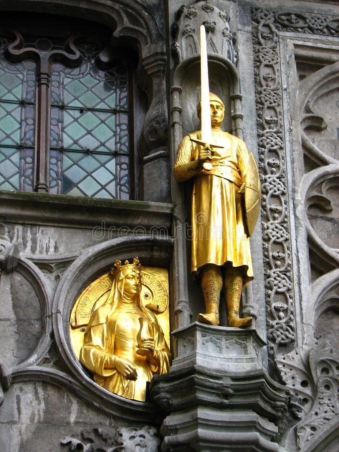 Brugge medieval staue. Gold plated statue in the centre of Brugge Belgium royalty free stock photos