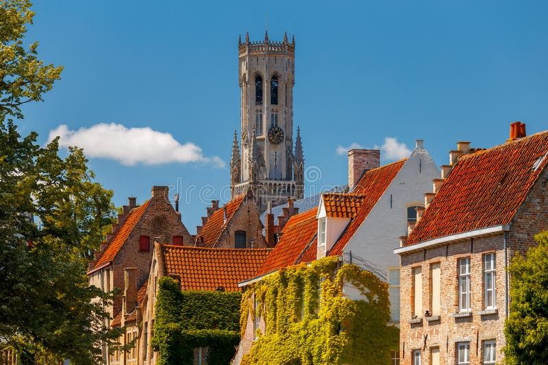 Brugge. The Tower Belfort. View of the facades of old houses and tower Belfort. Brugge. Belgium stock images