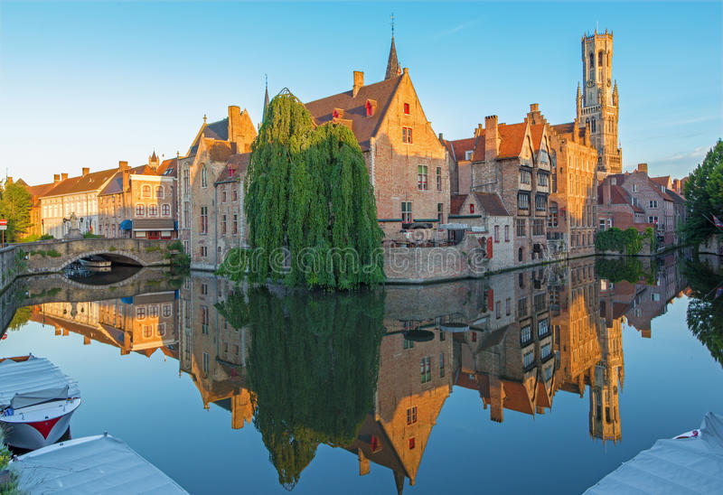 Brugge - View from the Rozenhoedkaai in Brugge with the Perez de Malvenda house and Belfort van Brugge in the background. In morning light royalty free stock photo