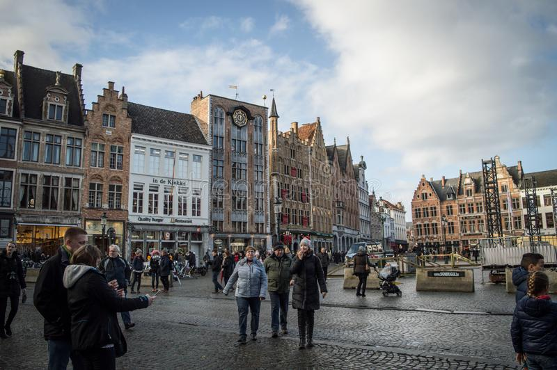 Brugge, West Flanders Belgium - January 2017: View of the main square and houses crowded with people on a clear winter day.  stock photos