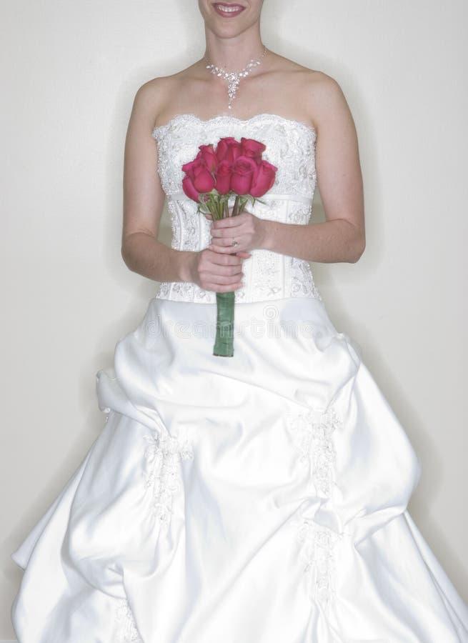 Bruid die haar Boeket houdt stock afbeelding