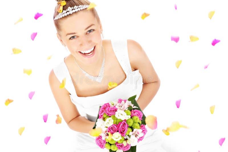 Bruid en bloemen stock afbeelding