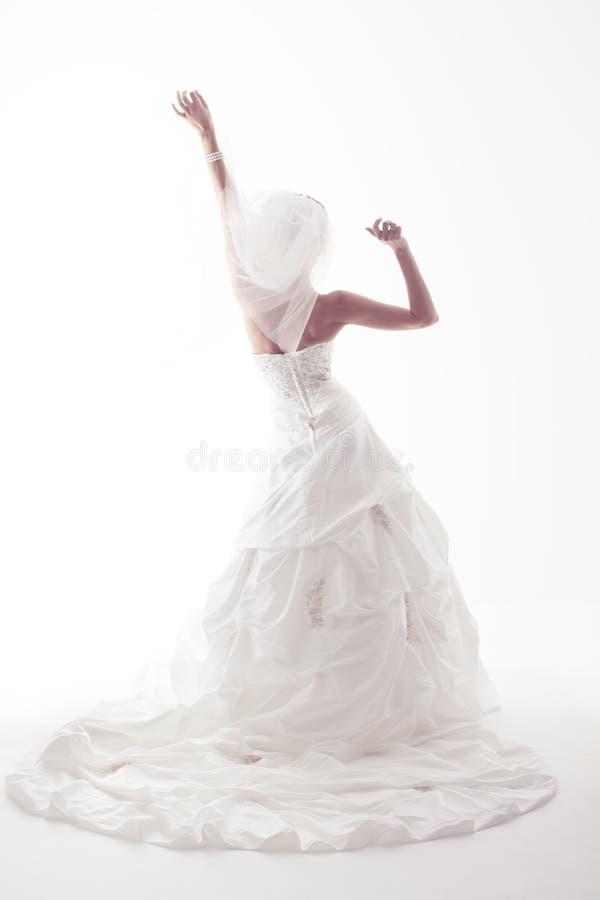 Bruid in huwelijks witte kleding royalty-vrije stock fotografie