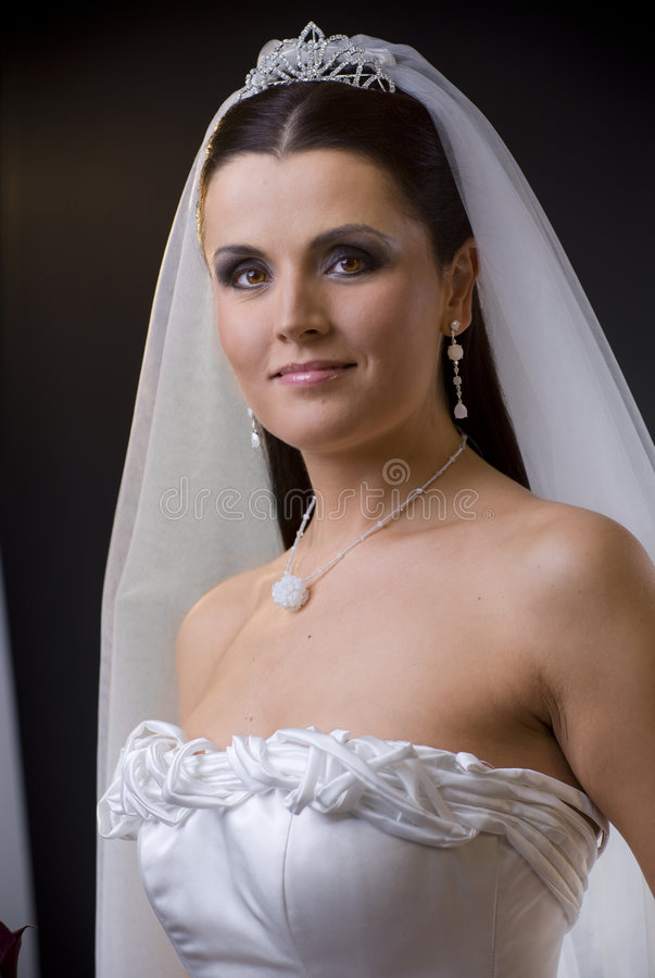 Bruid in huwelijkskleding royalty-vrije stock afbeeldingen