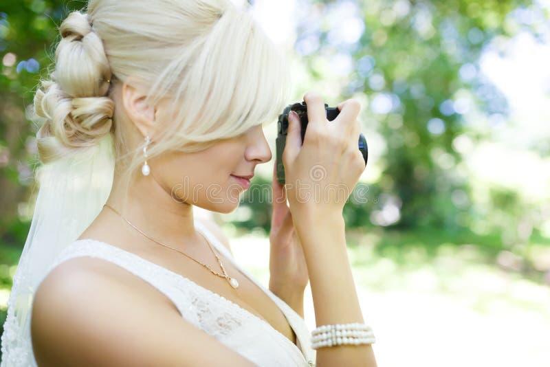 Bruid met camera stock foto's