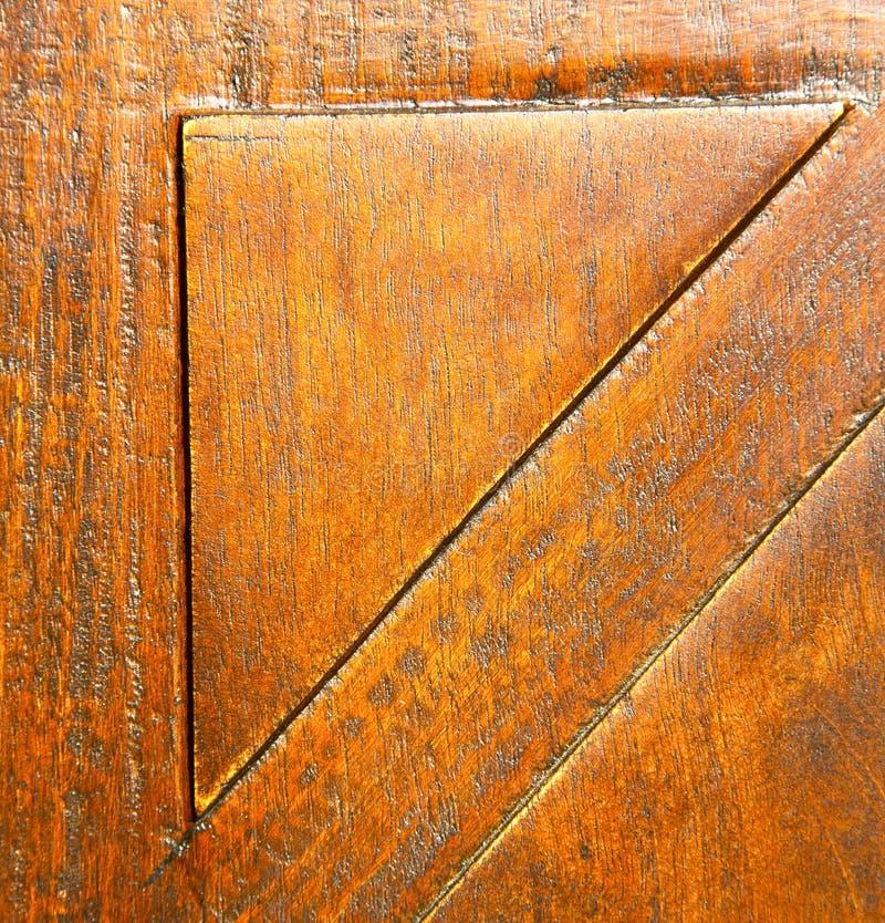 in bruin de kloppersmetaal houten lombar Italië van het mozzate roestig messing royalty-vrije stock afbeelding