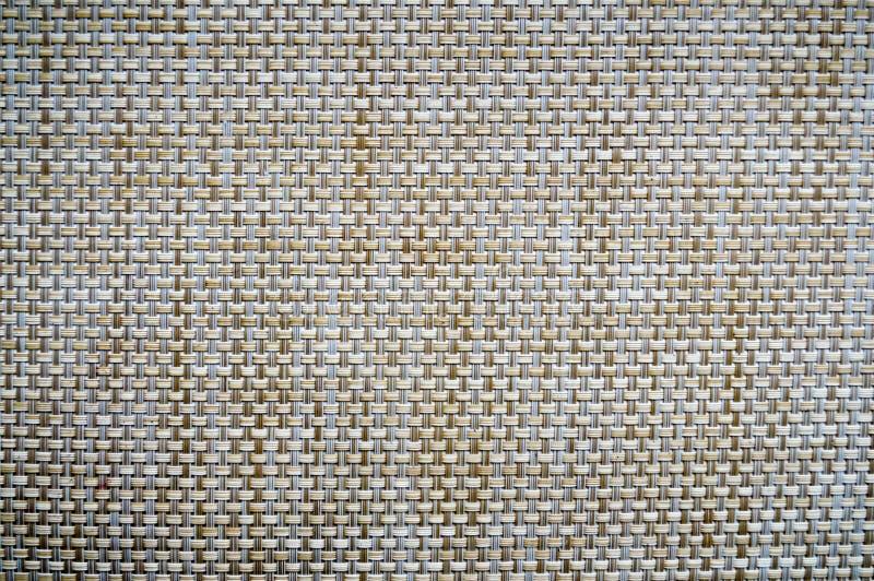 Bruin-geel-beige rieten, plastic grill, textuur royalty-vrije stock afbeelding