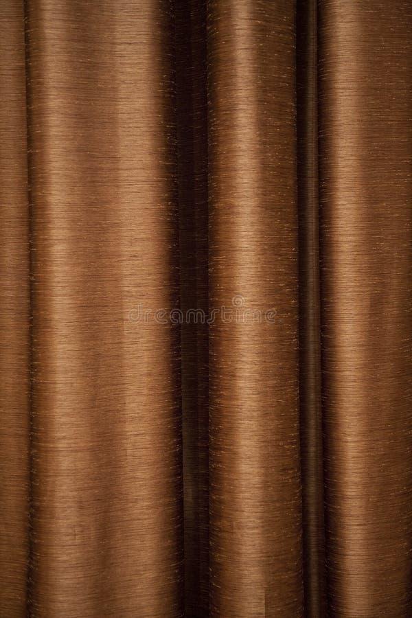 Bruin/goldish gordijn stock afbeelding