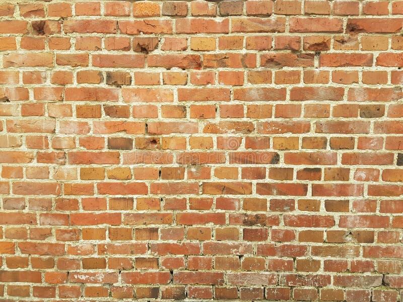 Bruine bakstenen muur van de stad stock foto