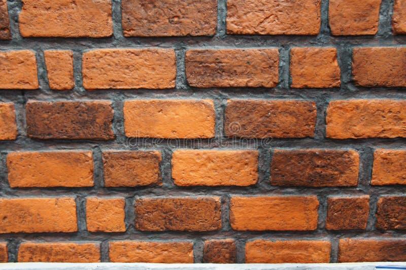 Bruine bakstenen muurachtergrond van de bouw stock foto