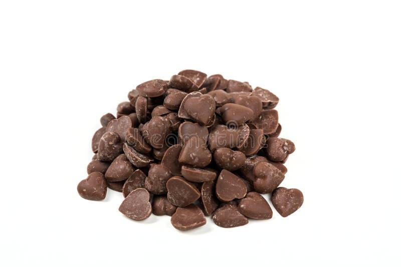 Bruine de spaanderstukken van de suikergoedhart gestalte gegeven melkchocola royalty-vrije stock afbeeldingen
